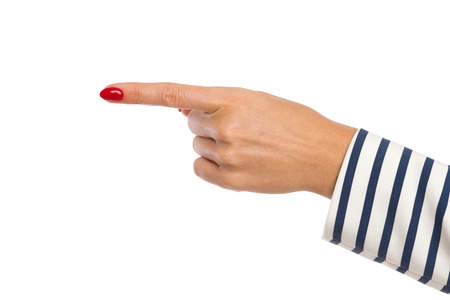 hand cuff: Close up of womans hand in striped cuff with red nails pointing. Studio shot isolated on white.