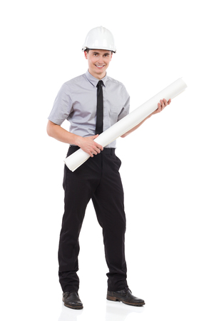 rolled paper: Smiling architect posing with rolled paper plan. Full length studio shot isolated on white. Stock Photo