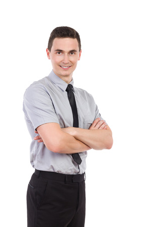 three quarter: Happy young man waiting with arms crossed. Three quarter length studio shot isolated on white.