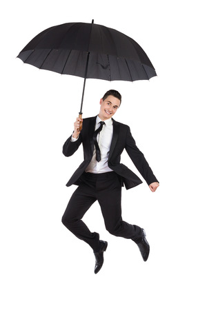 flying man: Jumping businessman with an umbrella. Full length studio shot isolated on white. Stock Photo