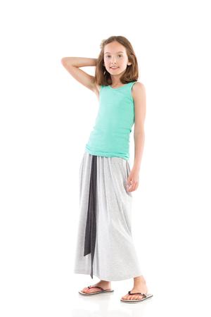 long skirt: Cheerful girl posing in gray long skirt. Full length studio shot isolated on white.