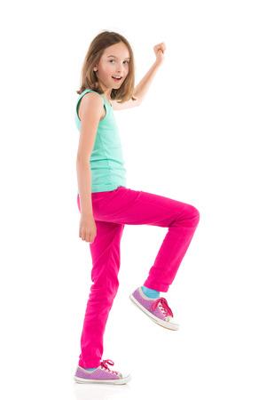 shouting girl: Shouting girl walks with arms raised. Full length studio shot isolated on white.