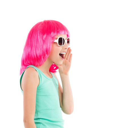 Close up of a shouting little girl in pink wig and sunglasses. Waist up studio shot isolated on white.