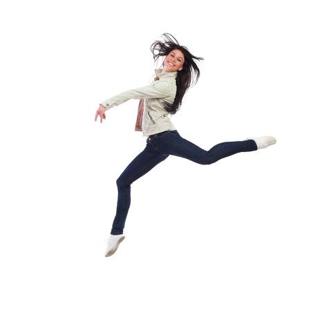 Smiling woman split jumping. Full length studio shot isolated on white.