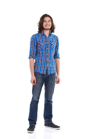 lumberjack shirt: Handsome young man standing and smiling. Full length studio shot isolated on white. Stock Photo