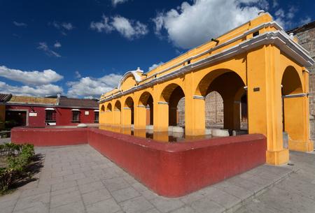 Yellow old washhouse in Antigua, Guatemala. Tanque de La Union. 版權商用圖片