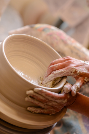 potter: to woman potter pottery hands Stock Photo