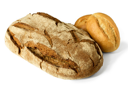 Fresh German sourdough rye bread & small bread rolls - high angle view isolated on white background