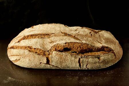 Fresh German sourdough rye bread on dark background