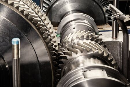 interlocked: Metal gears. Gear wheels of the engine. Stock Photo