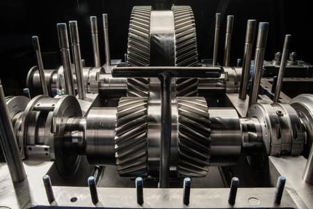 steam turbine: A part of a small steam turbine. Metal gears. Gear wheels of the engine.