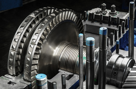 steam turbine: A wheel of a small steam turbine. Stock Photo