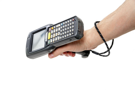 Mans hand holding a barcode scanner. The scanning device is directed downwards to the left. Isolated on white background. Stock Photo