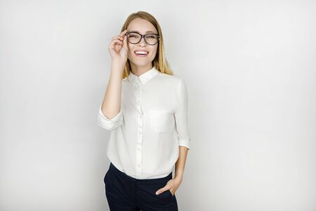 young beautiful pleased blonde business woman in eyeglasses after successful business meeting isolated white background