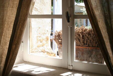 View thru old window  Some lavender on windowsill photo
