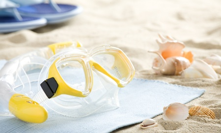 Snorkel and mask on the beach Bathing in the background tab