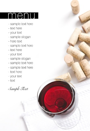 Winery menu project  Various corks and glass filled with red wine  Space for text isolated on white