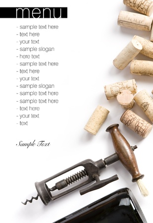 Winery menu project  Unique old corkscrew, corks and bottle of wine  Space for text isolated on white