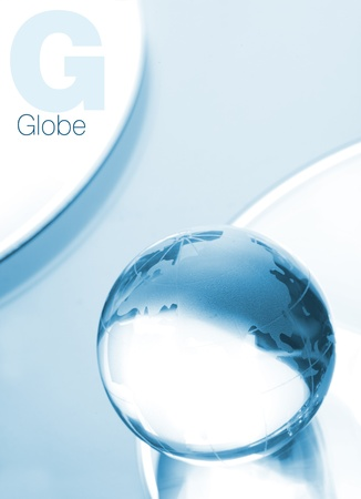 Globe made of glass in blue ambient light  Space for text logo isolated on white  photo