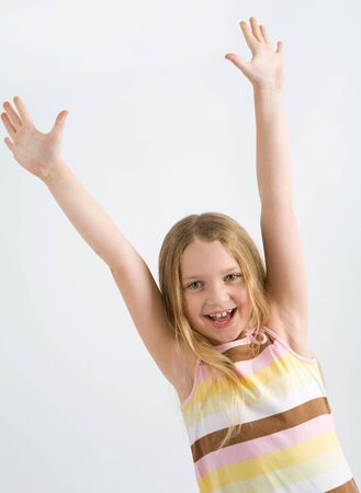 Happy little girl with her hands up Stock Photo - 13536301