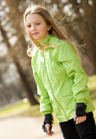 Blonde girl with protective gloves photo
