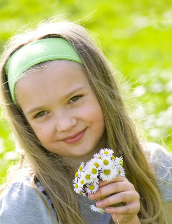 Beautiful blonde girl with daisies Stock Photo - 13536365