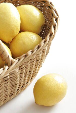 acidity: Lemons in a wicker basket Stock Photo