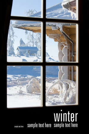 view through window on wooden building covered with snow photo