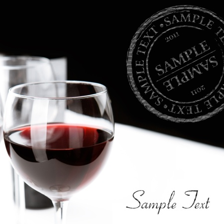 Glasses of red wine on white table cloth  Space for text