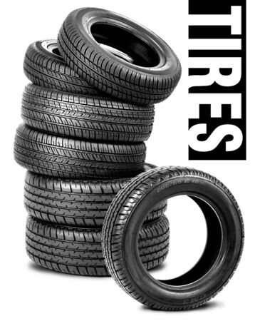 Pyramid of tires isolated on white photo