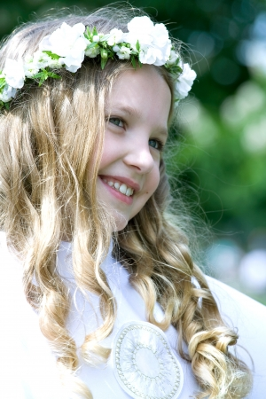 First Communion beautiful girl Stock Photo