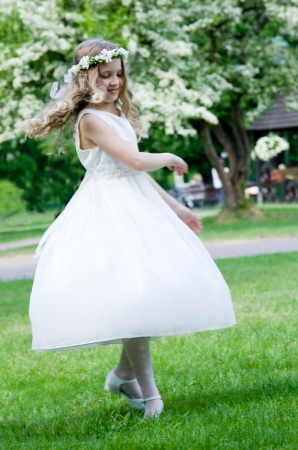 First Communion - happy dance on green background Stock Photo