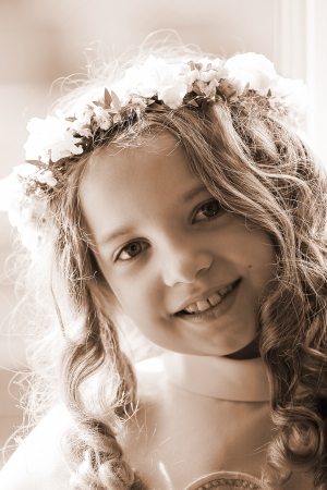 First Communion beautiful girl - sepia photo