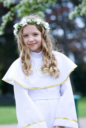 First Communion beautiful girl  IHS on her chest Stock Photo - 14164318