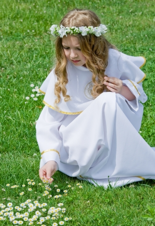 First Communion beautiful girl  IHS on her chest Stock Photo - 14164321