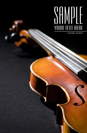 Close-up on violin  Space for text isolated on black