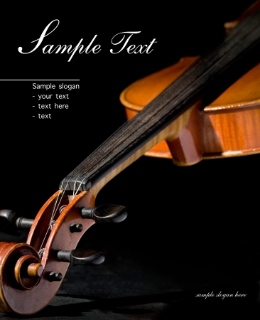 Old violin on black  Space for text