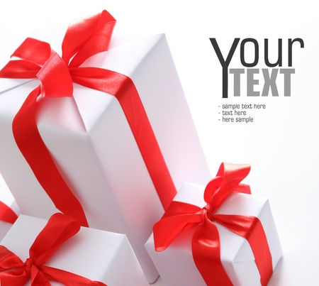 birthday gift: White presents with red ribbon  Space for text Stock Photo