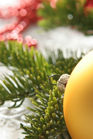 fir twig: Closeup on golden glass-ball and fir twig