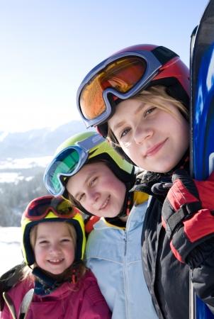 �Happy girls with ski