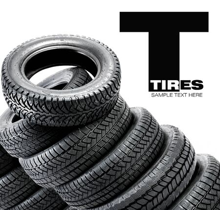 Pyramid of tires isolated on the background photo