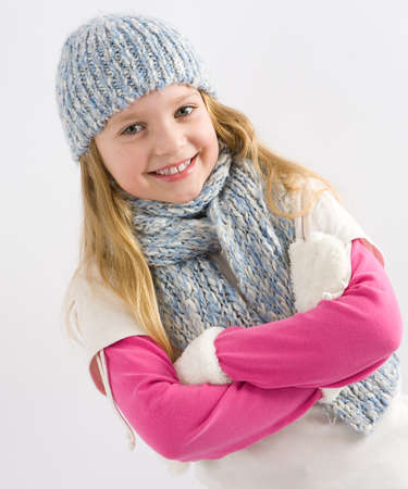 Happy little girl in winter clothes Stock Photo - 16380376