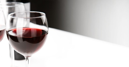 handle bars: Glass of red wine on white table cloth