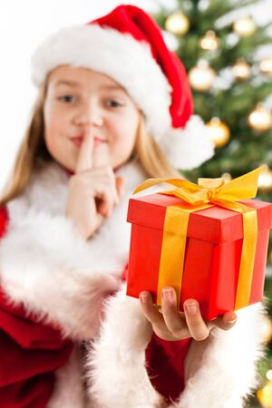 Young blonde girl holds present  Focus on gift box Stock Photo - 16613837
