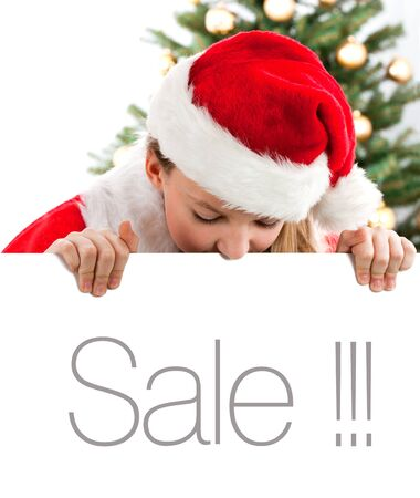 Girl holding empty white banner  Christmas tree in background Stock Photo - 16613824