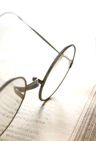 Old glasses on ancient book Stock Photo - 16685958
