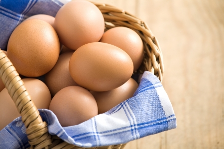 Easter egg in a basket with blue cloth  Stock Photo