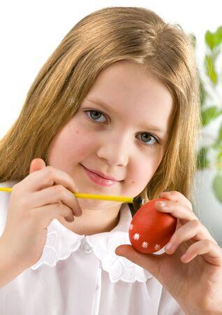 Girl painting easter egg  photo