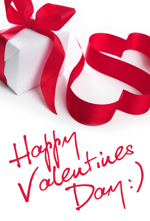 White present with ribbon stylized on hearts  Stockfoto