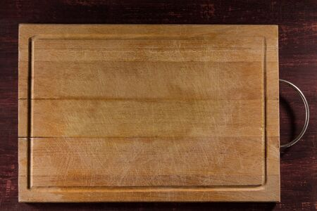 Empty cutting board on planks food background concept